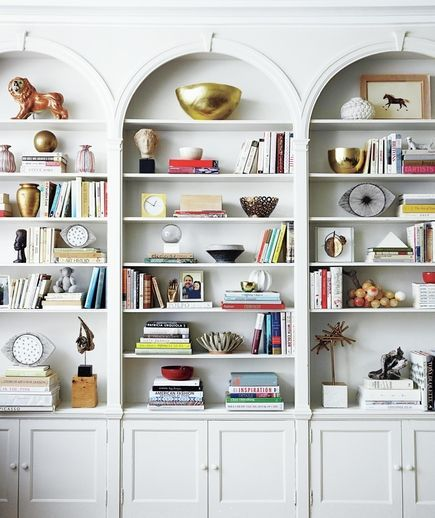 perfectly decorated built in bookshelves