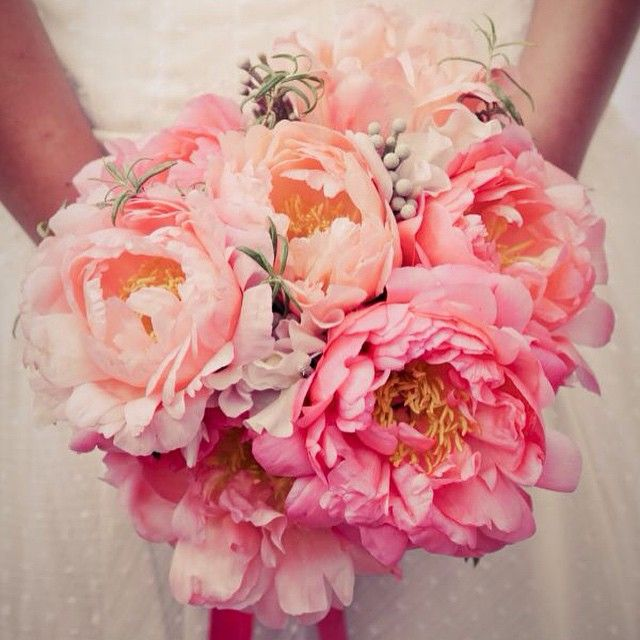Peony season has arrived! Bride Aurelie carried this fluffy bouquet of Coral Charm peonies at her handmade wedding in Reims, France.