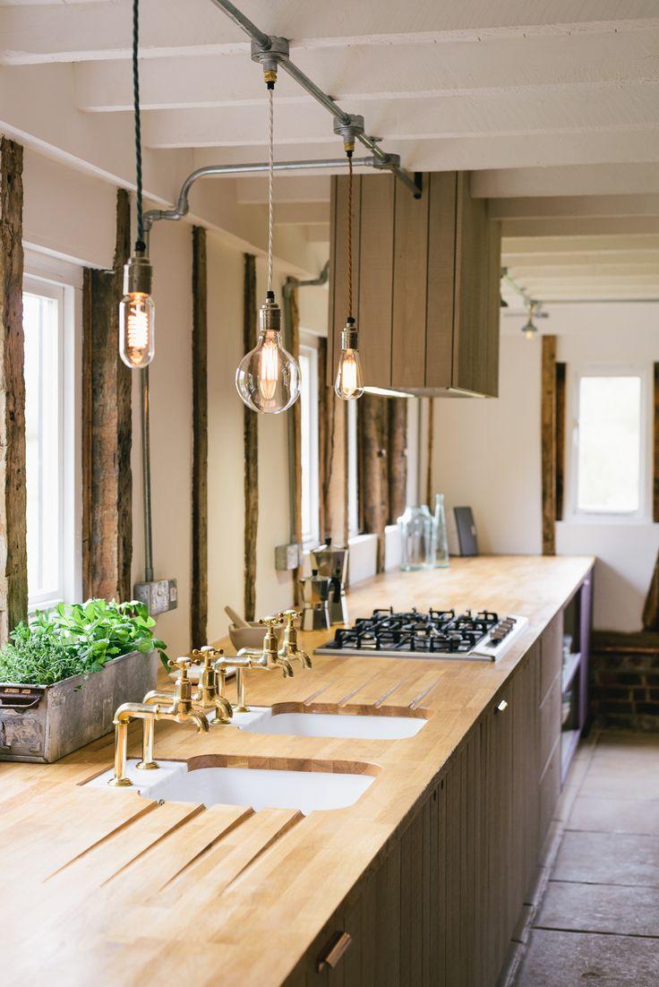 An 8 metre long run with an oak worktop and beautiful twin sinks