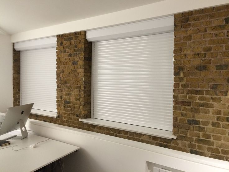 Happy clients! Our  RSG5100 Continental Roller Shutters securing some offices near London Bridge.