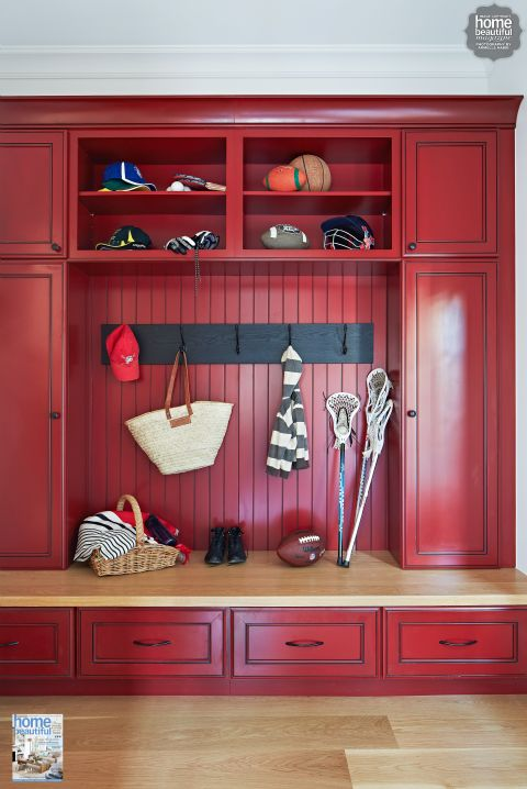 A bold red American-style mud room keeps everything stylishly organised...I wonder what color that is