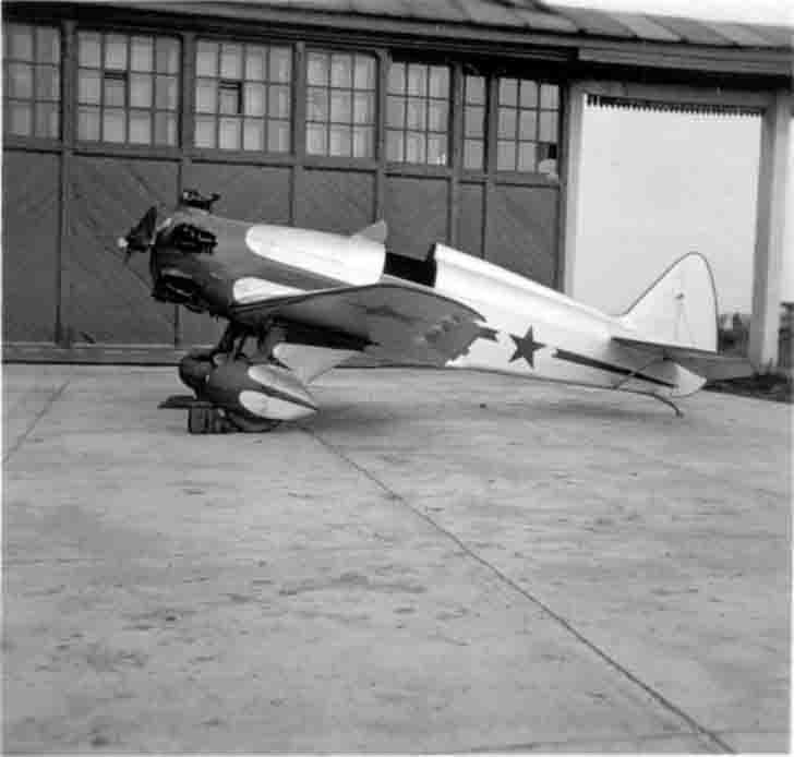 Soviet training aircraft UT-1 is at the airport before a hangar.  Photo taken from the Yakovlev Design Bureau behalf from the technical documentation for training aircraft UT-1.