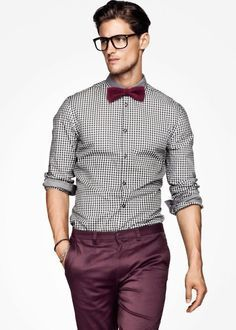 Consider teaming a monochrome gingham long sleeve shirt with dark red chinos for an easy to wear, everyday look. Shop this look on Lookastic: https://lookastic.com/men/looks/white-and-black-gingham-long-sleeve-shirt-burgundy-chinos-burgundy-bow-tie/18525 — Burgundy Bow-tie — White and Black Gingham Long Sleeve Shirt — Burgundy Chinos