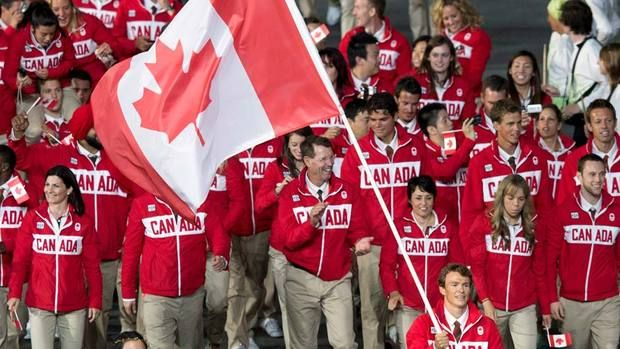 Triathlete Simon Whitfield carries the flag for Team Canada as the Canadians enter the stadium during the opening ceremonies for the 2012 Olympic Games in London on Friday.