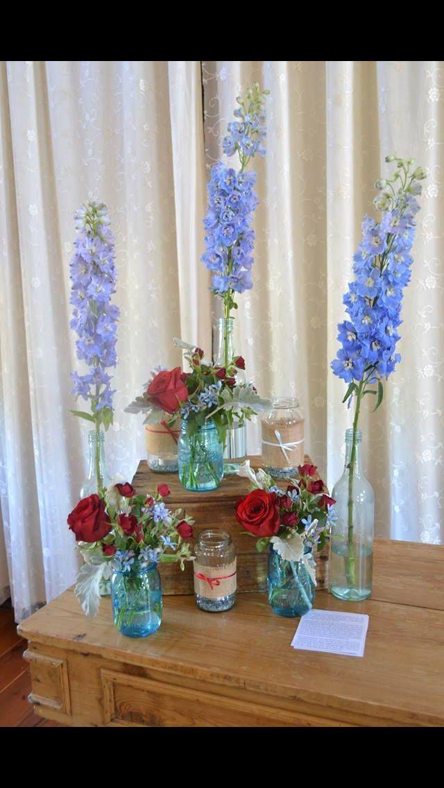 #altarflowers #redblue #balljars #masonjars #blueglass #redroses #redcarnations #blueflowers #rusticwedding