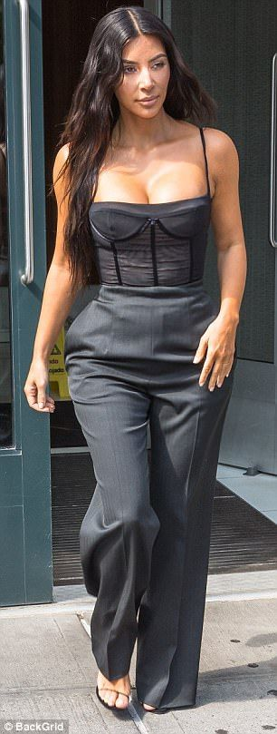The 36-year-old star left her hotel for an interview on The View dressed in a tight bustier and loose pinstripe trousers.