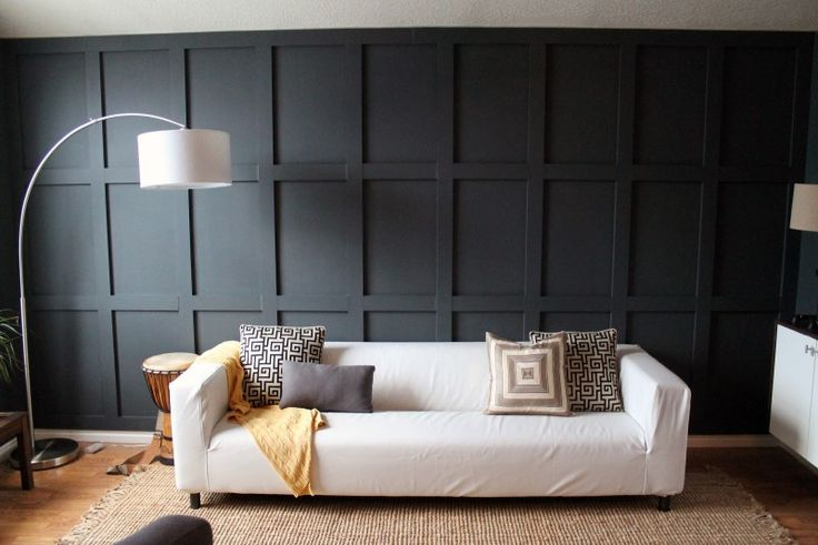 Gorgeous Black Wooden Plank Walls With White Long Couch And Arch White Shade Standing Lamp