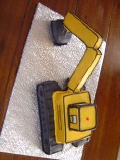 Best 25 excavator cake ideas on pinterest construction for Digger cake template