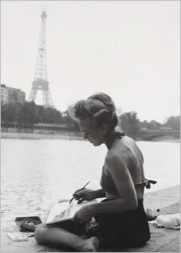 June 1949, Paris, Eiffel tower, young woman painter on the Seine banks KEYSTONE