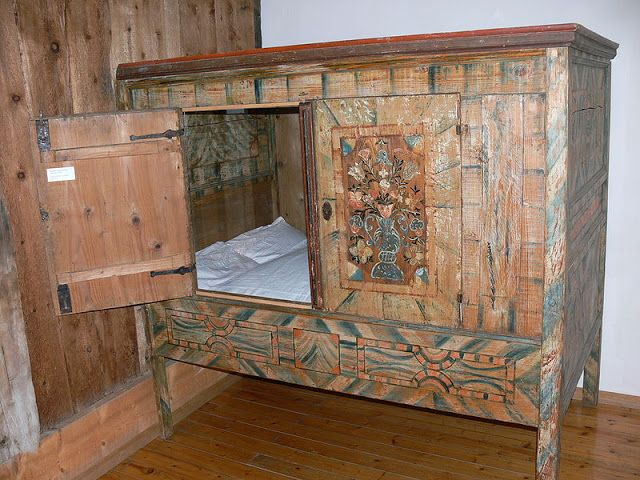 Breton box bed. Can't tell if it'd be cozy or creepy in there.