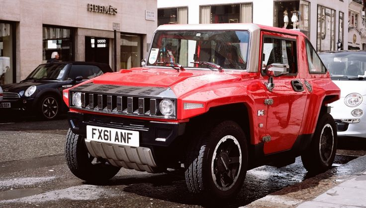 www.myelectricvehicle.org - MEV electric mini HUMMER HX flat red outside Hermes shop in London