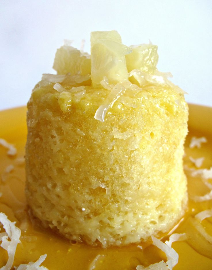3-2-1 Piña Colada Cake-individual vanilla cake filled with sweet shredded coconut and juicy bits of pineapple......topped with luscious coconut cream syrup! Cooks in the microwave in 1 minute!  @ themondaybox.com  #mug cakes #microwave cakes #piña colada