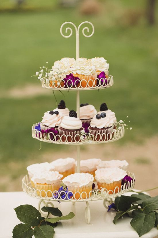vintage cupcake stand with berry topped cupcakes