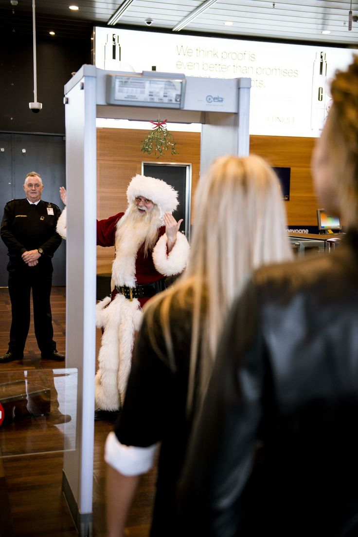There he is! Santa just checked in to the Airport. Anyone want a Christmas kiss for the roa… um… air?   #CPHchristmas13