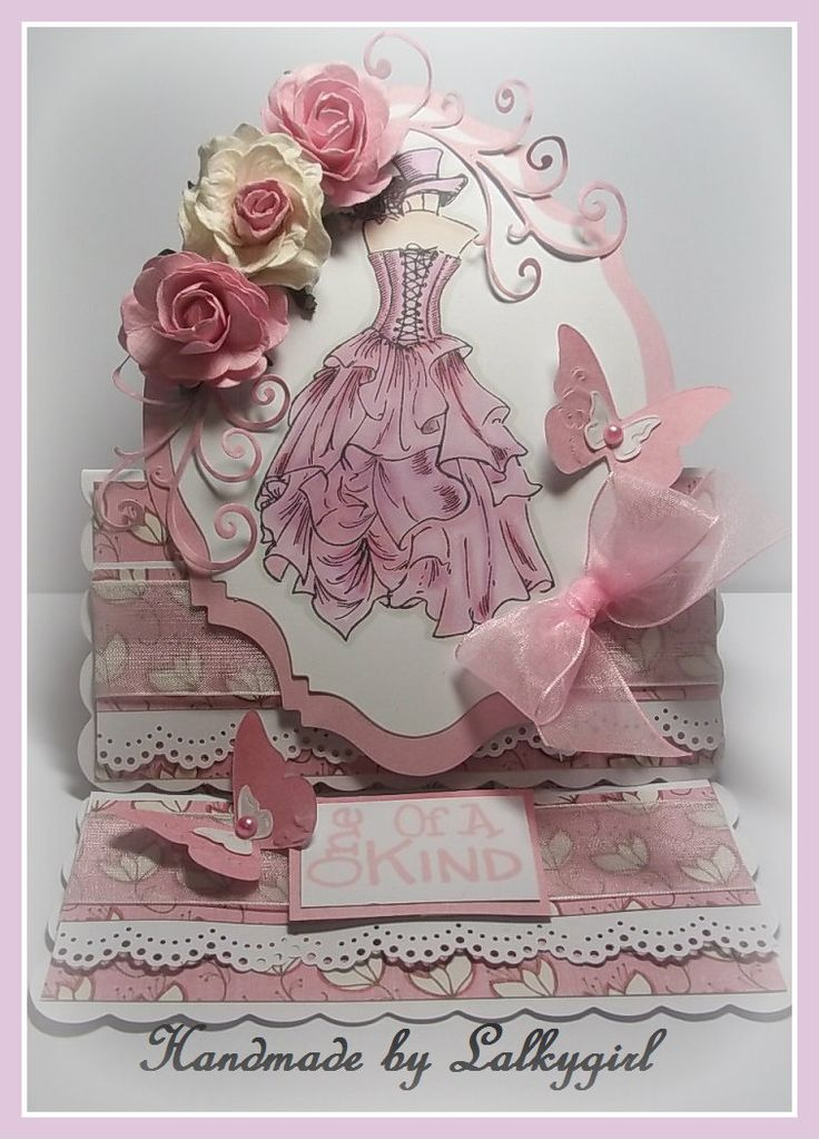 I would like to try something like this -- made using ,promarkers ,kanban stamps,mulberry crafts flowers,sizzix embosslits butterfliy dies,memory box swirls,ribbon and pearls from meiflower crafts and a martha stewart edge punch.