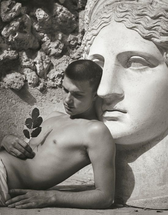 "Herbert List | ITALY  Rome  ""Youth and Roman bust"". 1949  The model is the Swiss painter Rolf DUERIG."