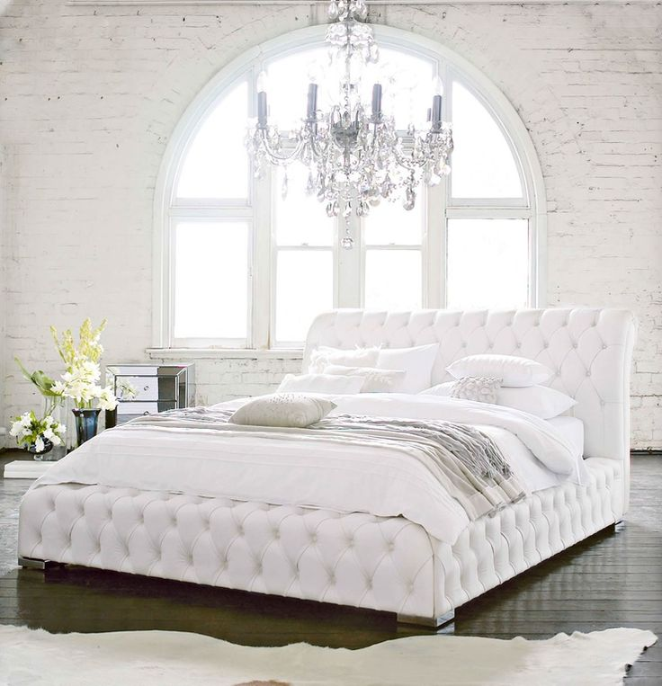 Eclectic Master Bedroom with Hi Groove Perugia Leather Queen Bed Frame, interior brick, Chandelier, Arched window