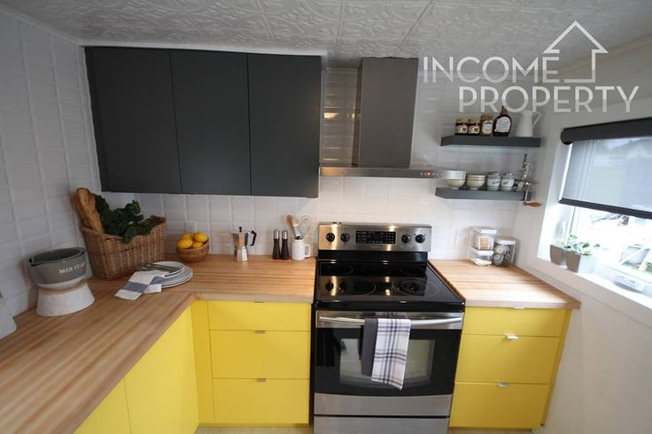 A splash of #ParaPaints Yellow Polka Dot Bikini (P5057-52) brightens up the kitchen cupboards on Justin's Episode of #IncomeProperty @hgtvcanada