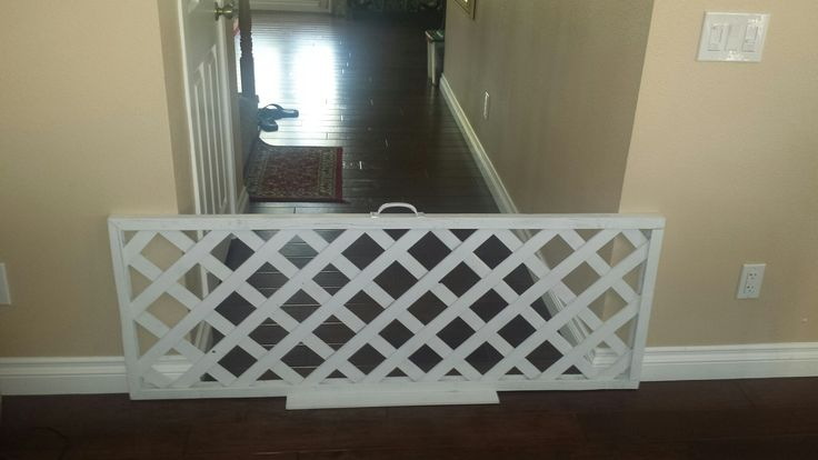 Inexpensive indoor dog barrier / fence for wider hallways under $25. Use a vertical lattice from HD. Cut off legs, paint, add a small base and handle. Works great as a barrier for dogs.