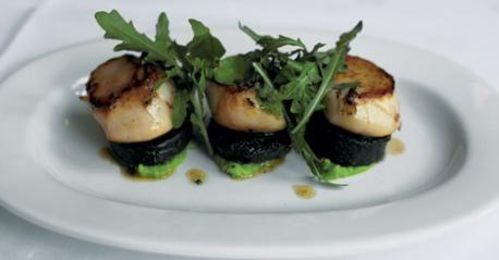 Seared scallops, black pudding, minted pea puree