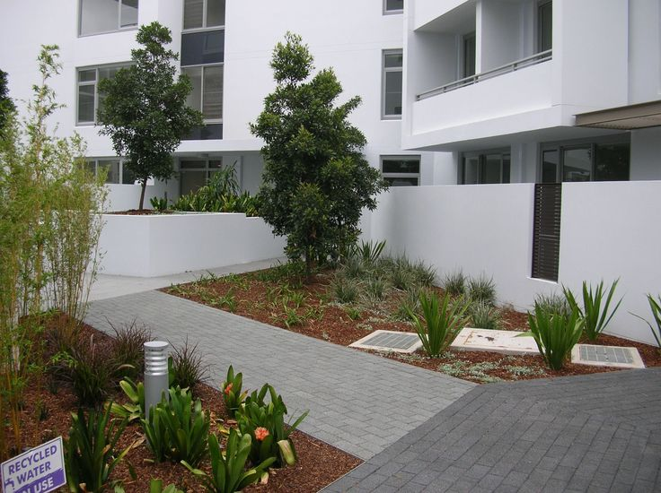 HydroSTON permeable concrete pavers used for a footpath at Tandara Apartments, Rhodes NSW, Australia.
