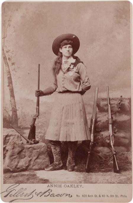 Annie Oakley with Four Guns.