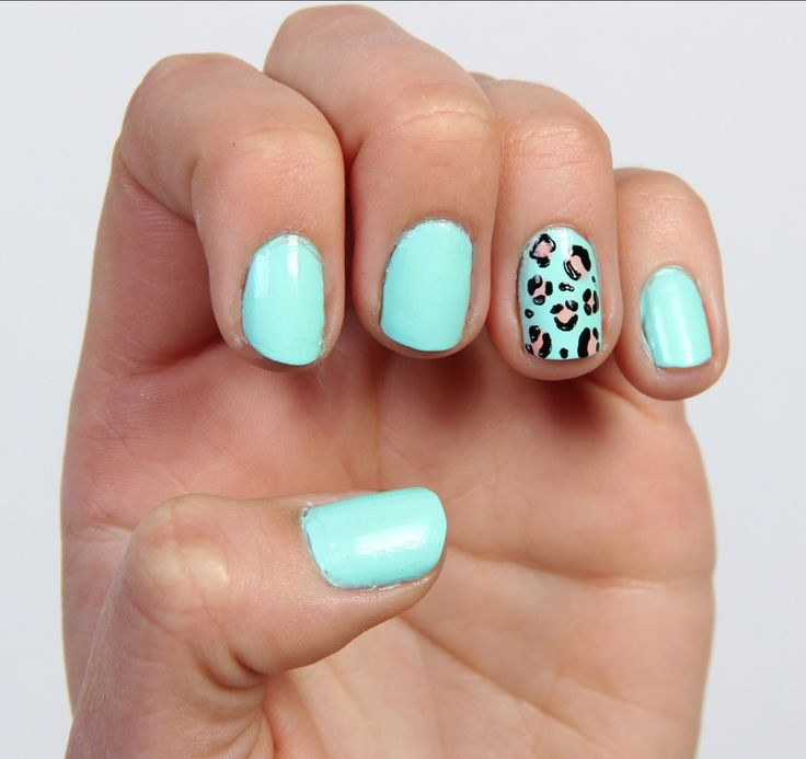 Light blue nails with a lepord print