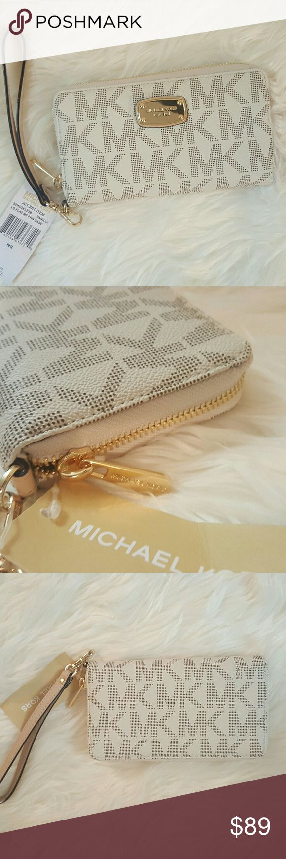 """NWT* Michael Kors Jet Set Travel Wallet * NWT* Michael Kors Jet Set Travel Wallet * Vanilla MK Signature Wallet * Multifunction Wristlet/Wallet*Approx. Dimensions:6 1/2"""" wide; 4"""" tall; 1'' deep Exterior: Zip around with a logo pull tab; Detachable leather wristlet strap*Interior: Inside is a fully lined interior; ID slot; Five interior credit card slots; Interior zip pocket, Bill compartments; Phone compartment; MK name embossed* Feel free to Inquire and ask Questions * Reasonable offers…"""
