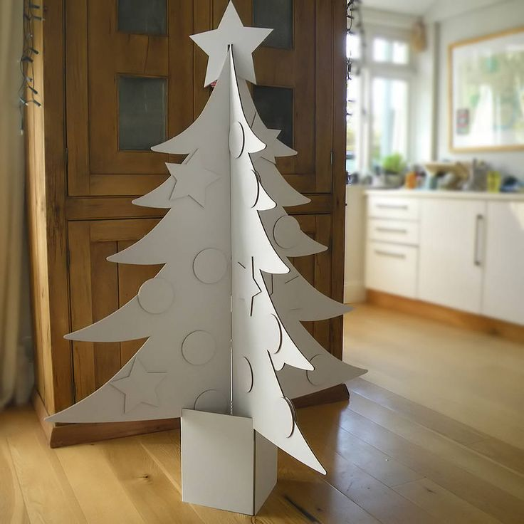 Make your own unique Christmas tree with this giant 3-D cardboard kit.Available in white or natural cardboard (please note - the tree in the above photo has been painted, other images show it in its natural state. We do not provide glue, paint, paintbrushes etc with the tree.)A great way to be creative and to decorate your room this Christmas in a contemporary, eco-friendly way, a giant 3-D cardboard Christmas tree! Delivered flat in a square cardboard shape so it's easy to paint without ...