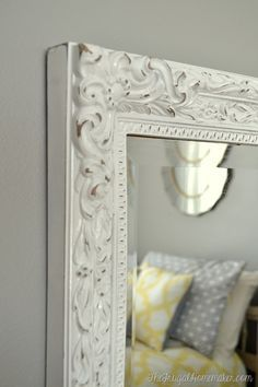 Spray painted and distressed yard sale mirror