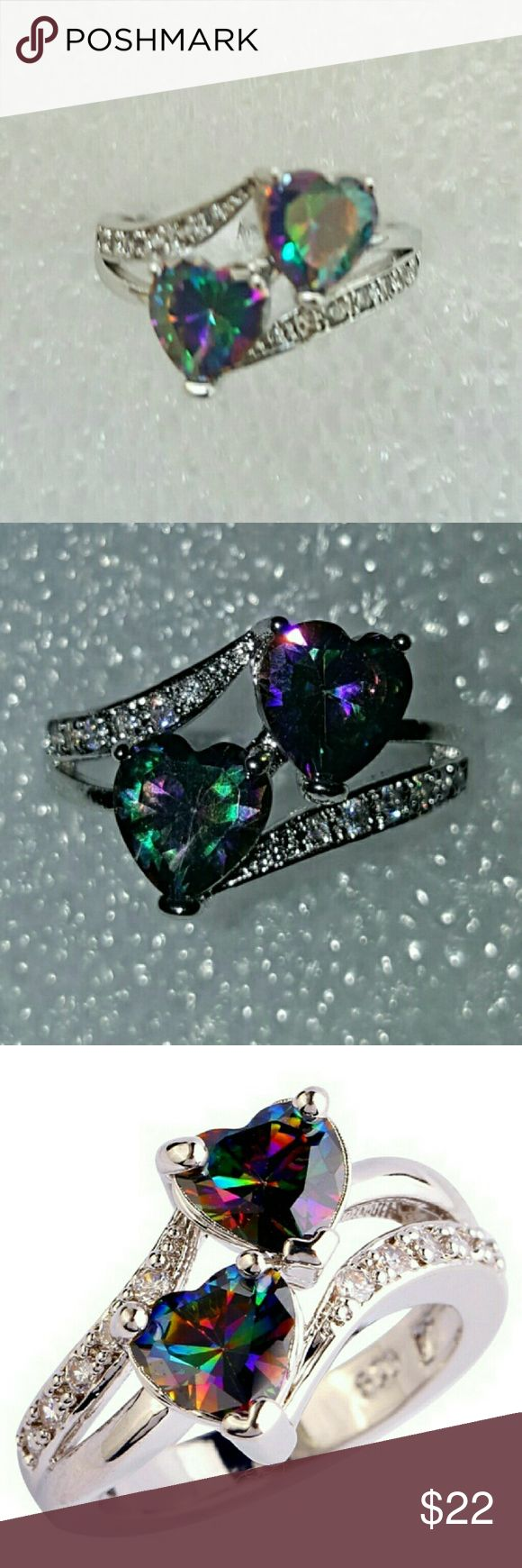 Mystic Topaz Heart Stones set in .925 Silver Mystic Topaz Heart Stones set in .925 Silver.  Side CZ stones line the Hearts to add additional sparkle to this fabulous ring.  Great gift for Valentines Day or Mothers Day. Life by Design  Jewelry Rings