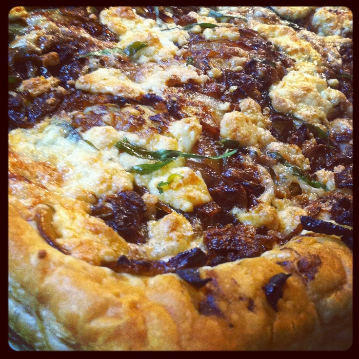 Caramelized onion, terragon, brie, blue, and gorgonzola cheese tart!