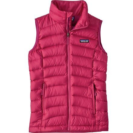 Keep your little one looking mountain chic in the Patagonia Girls' Down Sweater Vest. Made with a polyester ripstop fabric, you won't have to worry about your little lady tearing a hole in it during her first snowball fight. And with a DWR finish, this vest will repel moisture leaving its 600-fill down dry and insulating. With two hand warmer pockets she'll be able to get her hands nice and warm when her digits get chilly.