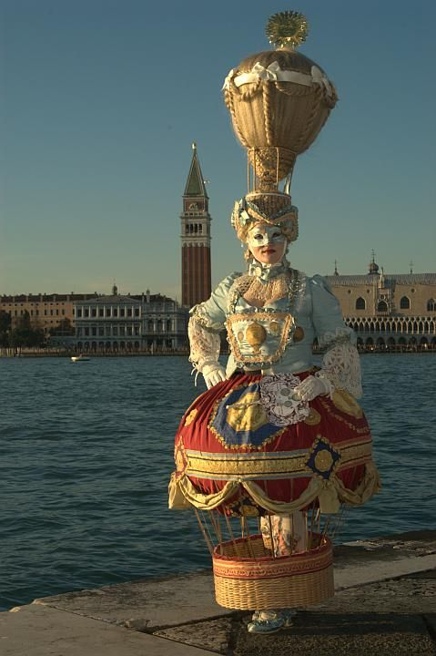 """Best Costume in Carnival of Venice 2007"" on the public parade in St. Mark's Square. Winner said: ""After being pregnant in 2006, having my daughter in December I felt a bit like a balloon. So I came up with the perfect costume for that: a hot air balloon. I always loved the old paintings of the balloons of the brothers Montgolfier. The fabric with the golden ornaments I found in a store in Venice once, the basket is half of our laundry basket at home and the hairy balloon is a Chinese…"