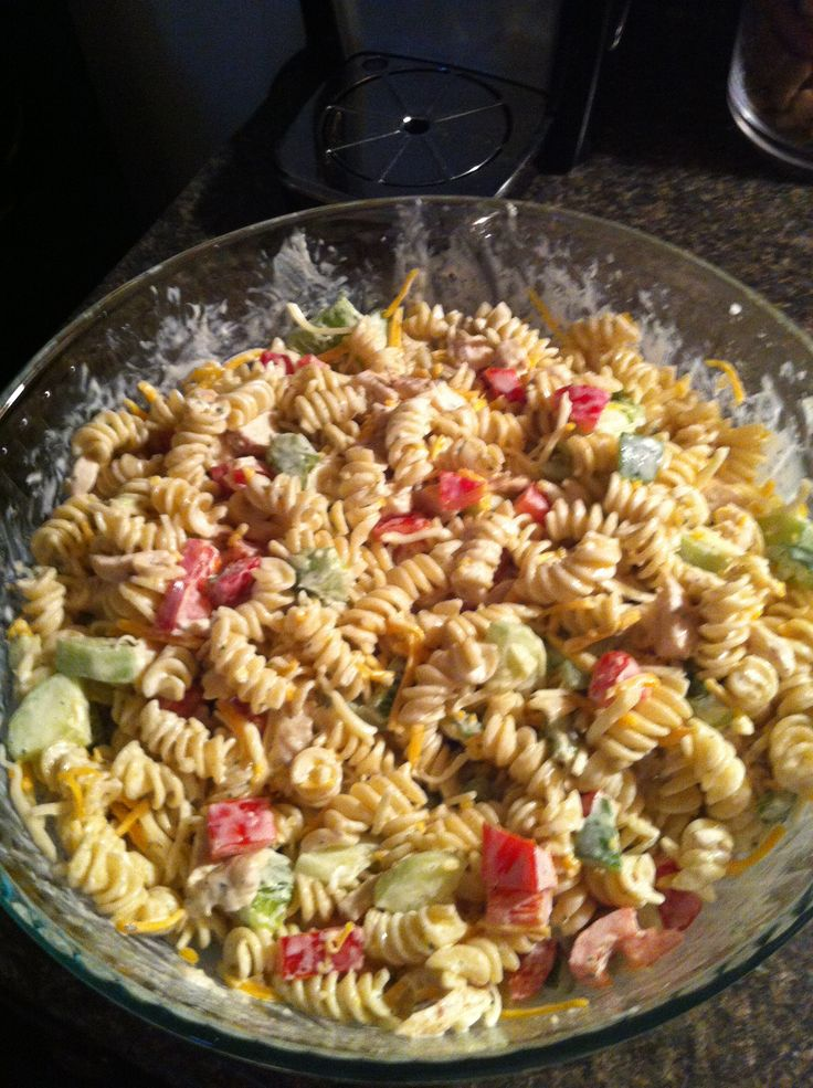 Chicken ranch pasta salad with green pepper, red bell pepper and cucumber, hidden valley ranch packet, cup of mayo, salt and pepper to taste!