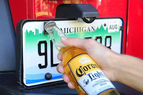 A license plate bottle opener that's perfect for a day at the beach or popping open your favorite sparkling water before work. | 37 Cheap Products That'll Make Your Car So Much Better