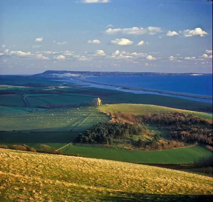 If you walk through Abbotsbury, you can see Chesil Beach stretching right back to Portland. | 51 Pictures That'll Make You Head Straight To The Jurassic Coast