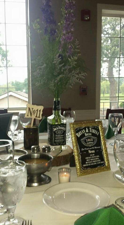 Whiskey bottle centerpieces with wine bottle table numbers ...