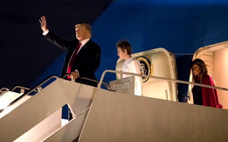 President Donald J. Trump with son, Barron and first lady, Melania arrive aboard Air Force One at Palm Beach International Airport in West Palm Beach, Florida on February 2, 2018. President Trump will be staying the weekend at Mar-a-Lago. (Allen Eyestone / The Palm Beach Post)