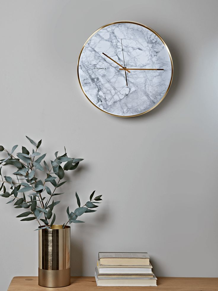 Encased in a simple brushed brass effect frame with matching brass hands and an elegant, marble effect face, our statement wall clock will make the perfect addition to your home office or living room. With a smooth, silent sweep rather than a tick, it also makes a wonderful bedroom clock.  Also available with a Black Marble or Cement effect, or as a petite Alarm Clock.