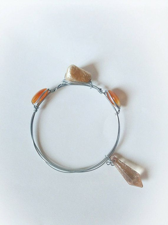 Check out this item in my Etsy shop https://www.etsy.com/listing/230105144/boho-crystal-charm-bangle