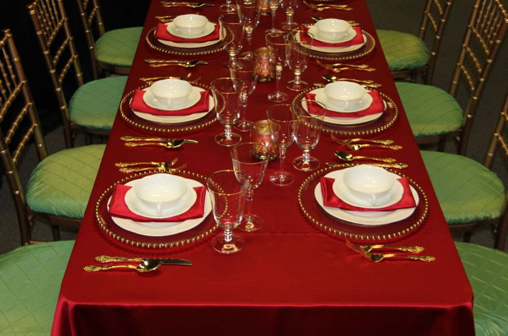 Red Satin Table Linen, Gold Chaivari Chair with Green Apple Pintuck Seat Cushion, Regal Gold Flatware, Gold Bead Charger, Arco Weiss China, Bella Gold Glassware & Red Satin Napkin| Chair-man Mills  Photography by: Debbie Kriz