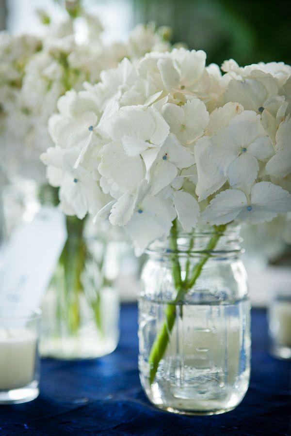 blue table clothes with white flowers: Ideas, White Flowers, Masons, Simple, Wedding, Centerpieces, Mason Jars, White Hydrangeas, Center Pieces