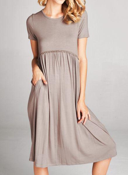 Taupe midi length dress with pockets and pom pom detailing.