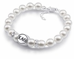 This Kappa Alpha Theta bracelet made with high quality sterling silver and Swarovski pearls, with Clear Swarovski Crystal Rondells for accent. Officially licensed college jewelry made in the USA.