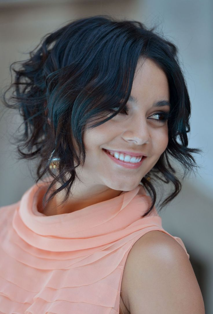 """Here's a fun way to switch up your look! Even if you don't have a true graduated bob, you can achieve the longer-in-front look with some strategic curling. Use a larger barrel curling iron (1"""" or 1-1/4"""") in front to create looser waves from about the eyebrows down, then go smaller (3/4"""") in back for tight, springy curls, starting about an inch or two from your roots."""