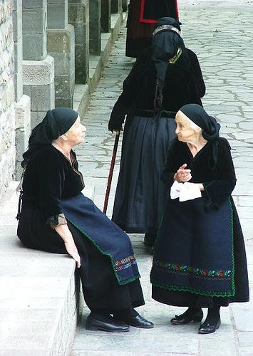 GREECE CHANNEL | Love the highlight/shadow on this. Grandma Tzeitel inspiration.  Old women waiting outside the church in Metsovo, Greece