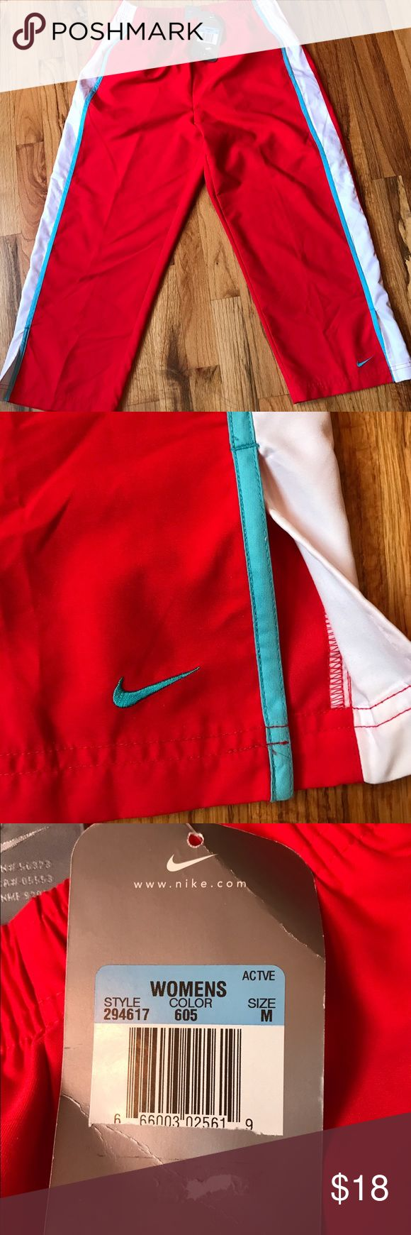 NWT Nike Capris size medium NWT Nike Capris. Baggier fit. Red with white and blue stripes. Inseam 24 inches. 100% polyester Nike Pants Track Pants & Joggers