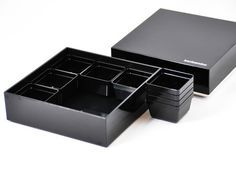 The Bento&co Boxes have two large containers. The upper one is divided into 3 parts and the lower one comes with no less than 9 removal little cases
