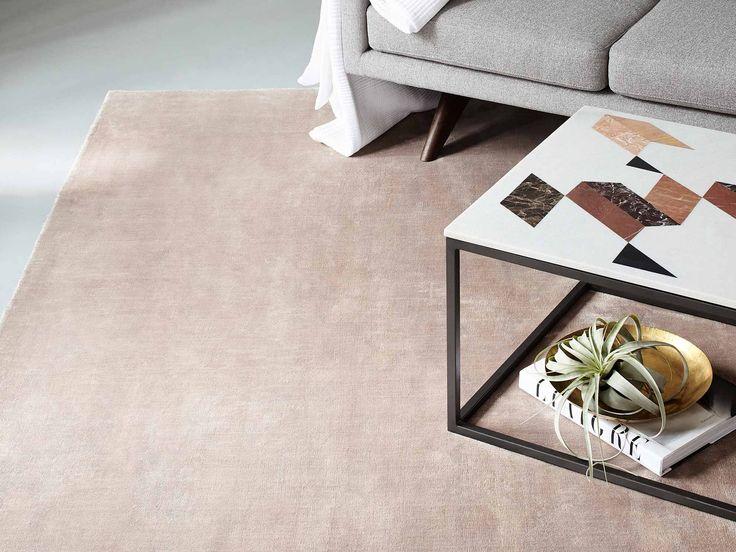 Peach rug in living room.